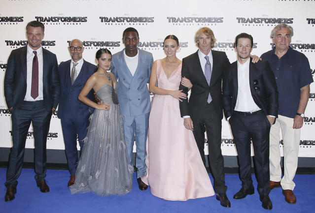 <p>Duhamel, Stanley Tucci, Moner, Jerrod Carmichael, Haddock, Bay, Wahlberg, and Jim Carter pose at the London premiere of <em>The Last Knight</em>. (Photo: Joel Ryan/Invision/AP) </p>