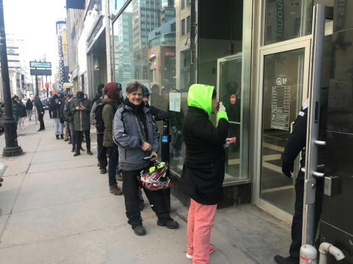 Customers queue on March 18, 2020, in front of a cannabis store in central Montreal, as coronavirus lockdowns triggered a brief surge in recreational use of the drug in Canada
