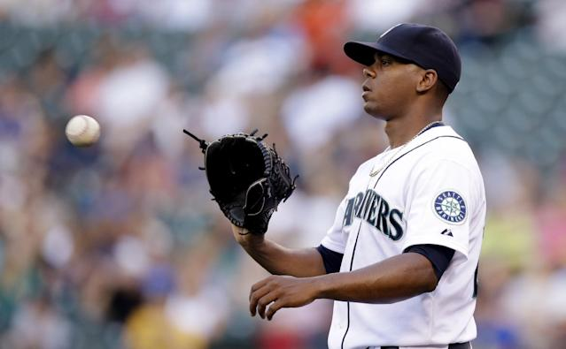 Seattle Mariners starting pitcher Roenis Elias gets the ball back after a flyout against the Minnesota Twins in the first inning of a baseball game Wednesday, July 9, 2014, in Seattle. (AP Photo/Elaine Thompson)