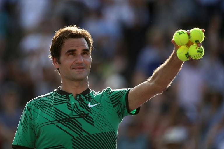 Roger Federer of Switzerland celebrates after defeating Tomas Berdych of Czech Republic in their Miami Open quarter-final match, at Crandon Park Tennis Center in Key Biscayne, on March 30, 2017