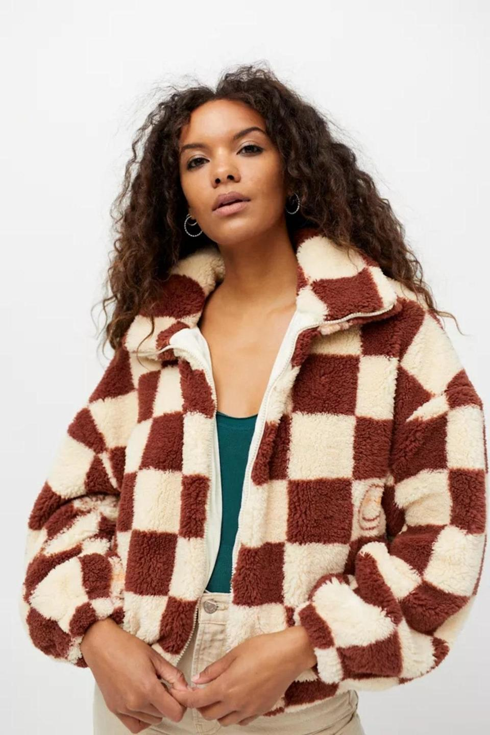 """Are we wrong to say you'll be dreaming about this checkerboard cutie tonight? $99, Urban Outfitters. <a href=""""https://www.urbanoutfitters.com/shop/uo-checkerboard-sherpa-fleece-jacket?color=029&type=REGULAR&quantity=1"""" rel=""""nofollow noopener"""" target=""""_blank"""" data-ylk=""""slk:Get it now!"""" class=""""link rapid-noclick-resp"""">Get it now!</a>"""
