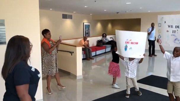 PHOTO: Candace Hall was surprised by her three children after defending her dissertation thesis for a doctorate in education. (Courtesy Candace Hall)