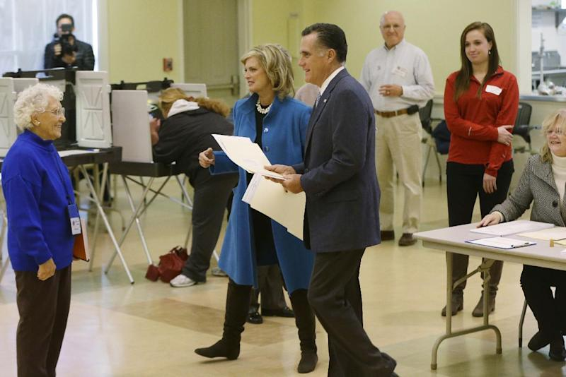 Republican presidential candidate, former Massachusetts Gov. Mitt Romney and wife Ann Romney arrive to vote in Belmont, Mass., Tuesday, Nov. 6, 2012.(AP Photo/Charles Dharapak)