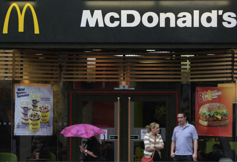 People gather outside a McDonald's restaurant in London, Sunday, Sept. 4, 2011. About 1,200 McDonald's restaurants in Britain will begin displaying the calorie count of each food and drink item on their wall-mounted menu boards this week, as part of a government-led program to fight obesity and promote healthier eating, the chain said Sunday. McDonald's already puts calorie information on its Web site and the back of its tray liners, but this is the first time the figures will be displayed prominently in its restaurants outside the U.S. The chain has similar calorie menu boards in New York City, which became the first in the U.S. to put a calorie posting law in place in 2008.The British program is voluntary, and relies on partnering companies to fulfill their health pledges. Other chains that have signed up to the British Department of Health calorie display program include Kentucky Fried Chicken, Pizza Hut and Starbucks. (AP Photo/Lefteris Pitarakis)
