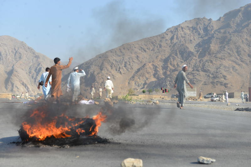 Men shout slogans against terrorists after a suicide attack among the protesters in Momandara district of Nangarhar province Afghanistan Tuesday Sept. 11 2018. A suicide bomber detonated his explosives-filled vest among a group of people protesting