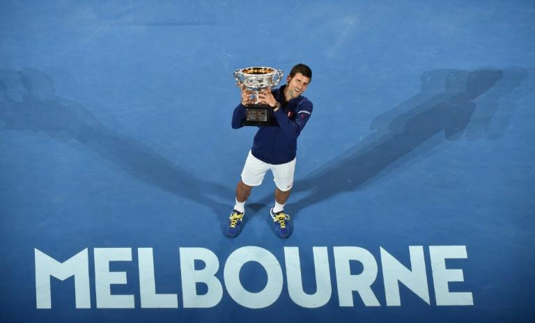 Novak Djokovic holds the Norman Brookes Challenge Cup for a record-equalling sixth time after beating Andy Murray in 2016