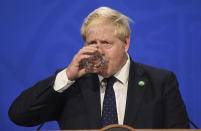 """Britain's Prime Minister Boris Johnson attends a media briefing in Downing Street, London, Tuesday, Sept. 7, 2021. Johnson has announced a tax increase to pay for the rocketing cost of the long-term care needed by Britain's growing older population. Johnson told lawmakers in the House of Commons that he had made the """"difficult but responsible"""" decision to hike taxes in order to raise 36 billion pounds ($50 billion) over three years for social care and the overstretched National Health Service. (Toby Melville/Pool Photo via AP)"""