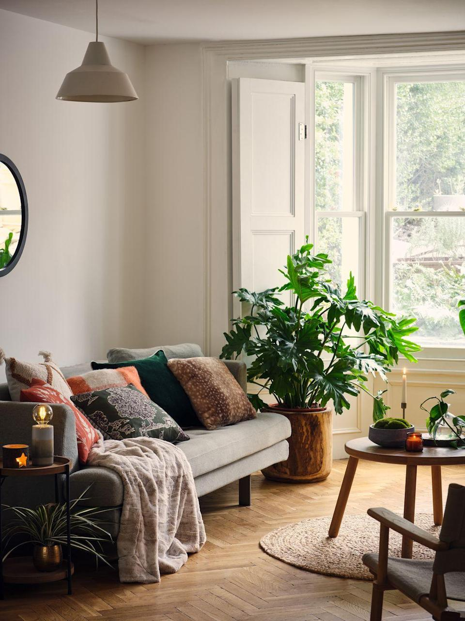 """<p>Centered around nature, the Forest Treasure trend is packed with roasted browns and bronze greens which combine natural textures with mid-century <a href=""""https://www.housebeautiful.com/uk/decorate/living-room/g32357518/living-room-accessories/"""" rel=""""nofollow noopener"""" target=""""_blank"""" data-ylk=""""slk:accessories"""" class=""""link rapid-noclick-resp"""">accessories</a>. Some of our favourites include the jute rug (£45), black round mirror (£20) and cosy checked cushion (£9). <br></p><p><a class=""""link rapid-noclick-resp"""" href=""""https://direct.asda.com/george/home/D26,default,sc.html"""" rel=""""nofollow noopener"""" target=""""_blank"""" data-ylk=""""slk:SHOP NOW"""">SHOP NOW</a></p>"""