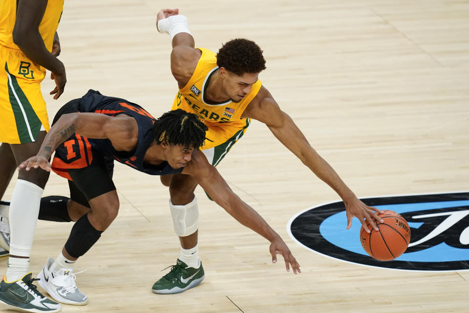 Baylor's MaCio Teague, right, and Illinois' Adam Miller go for a loose ball during the second half of an NCAA college basketball game Wednesday, Dec. 2, 2020, in Indianapolis. (AP Photo/Darron Cummings)