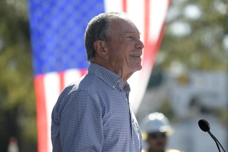 "In this Feb. 8, 2019, photo, former New York City Mayor Michael Bloomberg speaks during a visit to an Orlando Utilities Commission facility in Orlando, Fla. Bloomberg measures his progress on climate change in metric tons. His political party, it seems, prefers big ideas. Many Democratic presidential contenders embraced the ""Green New Deal"" immediately after it was released last week.(AP Photo/Phelan M. Ebenhack)"