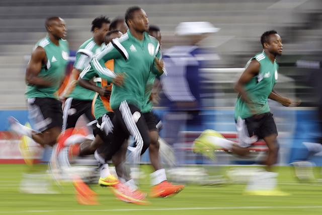 Nigerian players warm up during an official training session the day before the group F World Cup soccer match between Iran and Nigeria at the Arena da Baixada in Curitiba, Brazil, Sunday, June 15, 2014. (AP Photo/Frank Augstein)