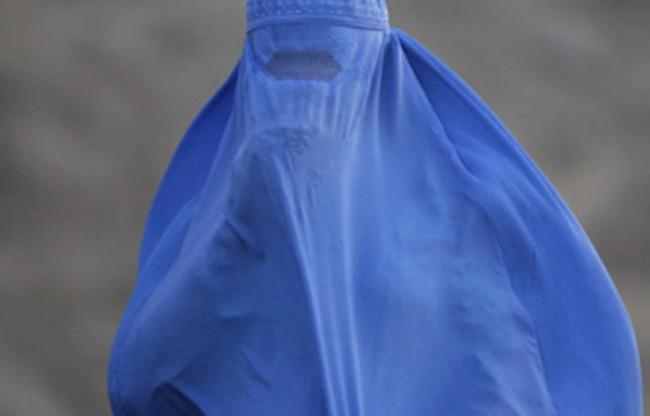 A woman wearing the traditional burqa.