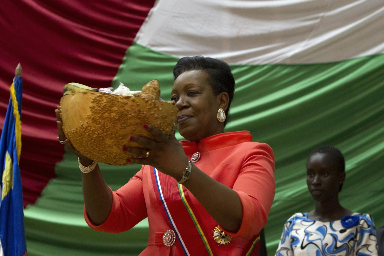 New parliamentary-elected interim President of the Central African Republic Catherine Samba-Panza receives a gift as part of local tradition during her swearing-in ceremony at the National Assembly in the capital Bangui January 23, 2014. REUTERS/Siegfried Modola (CENTRAL AFRICAN REPUBLIC - Tags: POLITICS)