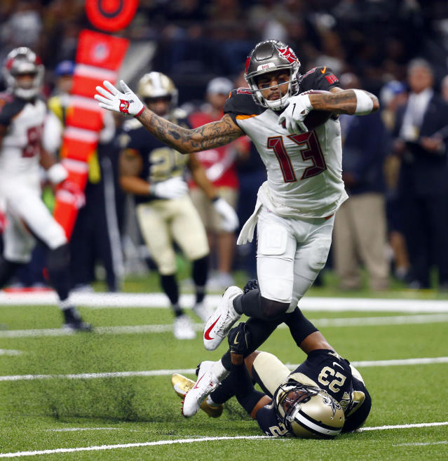<p>Tampa Bay Buccaneers wide receiver Mike Evans (13) carries against New Orleans Saints cornerback Marshon Lattimore (23) in the second half of an NFL football game in New Orleans, Sunday, Sept. 9, 2018. (AP Photo/Butch Dill) </p>