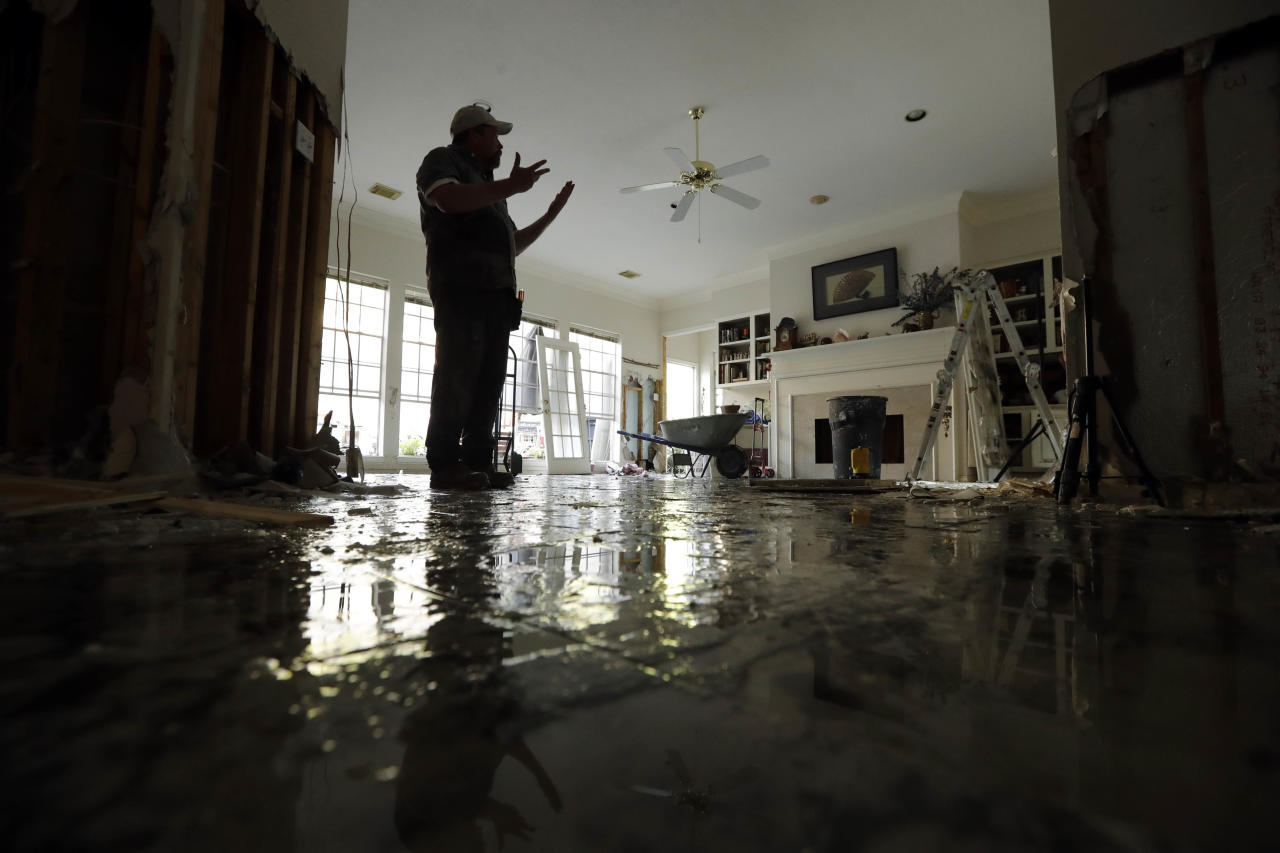 <p>Greg Ingram looks around his water-damaged home after floodwaters from Tropical Storm Harvey drenched the city Thursday, Aug. 31, 2017, in Houston. (Photo: Gregory Bull/AP) </p>