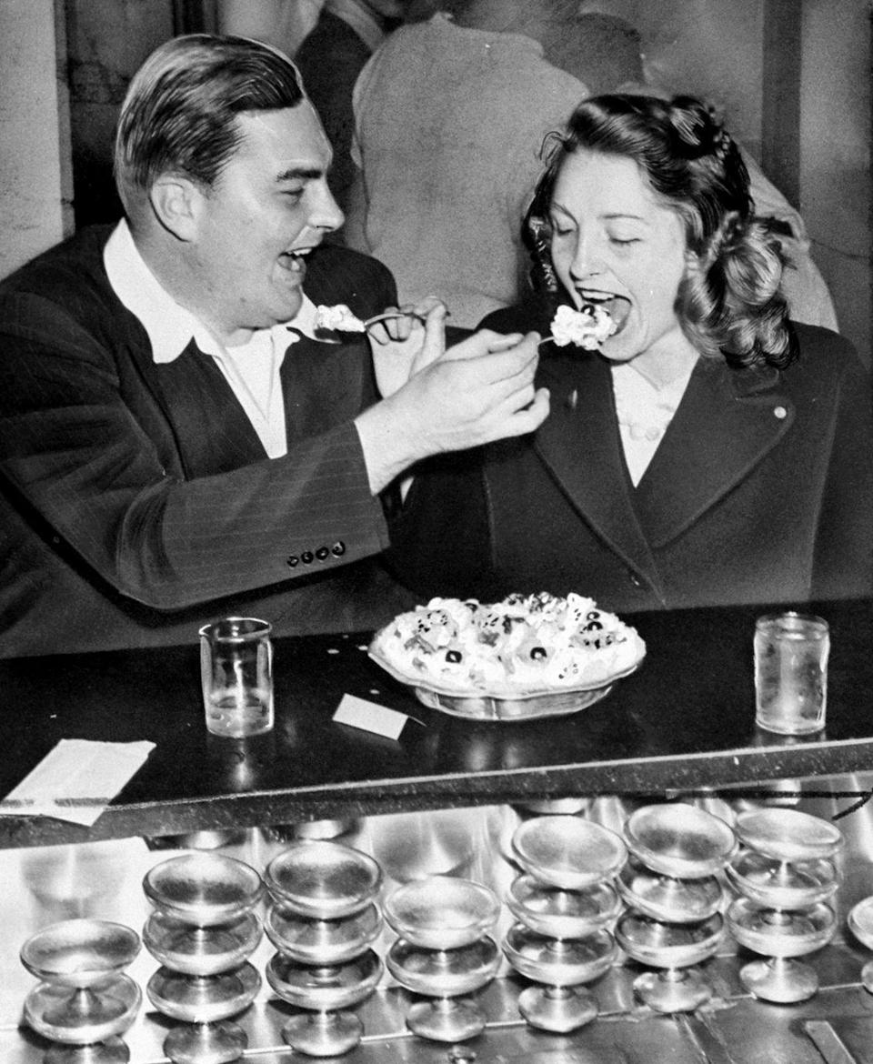 """<p>A husband and wife enjoy the $1.50 """"Super Duper for Two"""" ice cream sundae special at Jahn's Ice Cream Parlor in Richmond Hill, New York. </p>"""