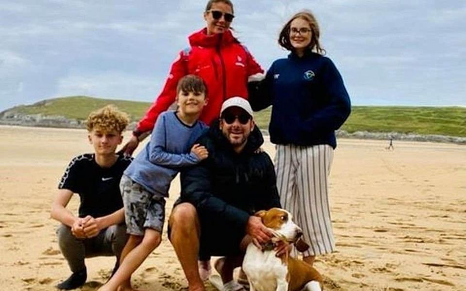 Kevin Viles (centre) pictured alongside his fiance Lisa and three children Henry, (13) Fletcher (9)and Caitlin (16) - SWNS