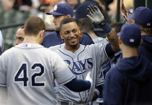 Tampa Bay Rays' Desmond Jennings, center, high-fives teammates in the dugout after hitting a solo home run in the first inning of a baseball game against the Baltimore Orioles on Tuesday, April 16, 2013, in Baltimore. (AP Photo/Patrick Semansky)