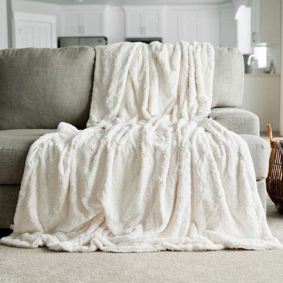 white faux fur throw draped over couch