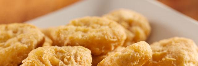 Golden chicken nuggets on a plate.