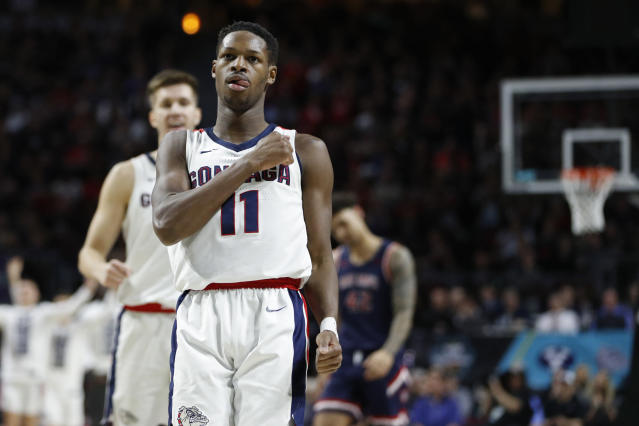 Gonzaga's Joel Ayayi (11) celebrates after scoring against Saint Mary's in the second half of an NCAA college basketball game in the final of the West Coast Conference men's tournament Tuesday, March 10, 2020, in Las Vegas. (AP Photo/John Locher)