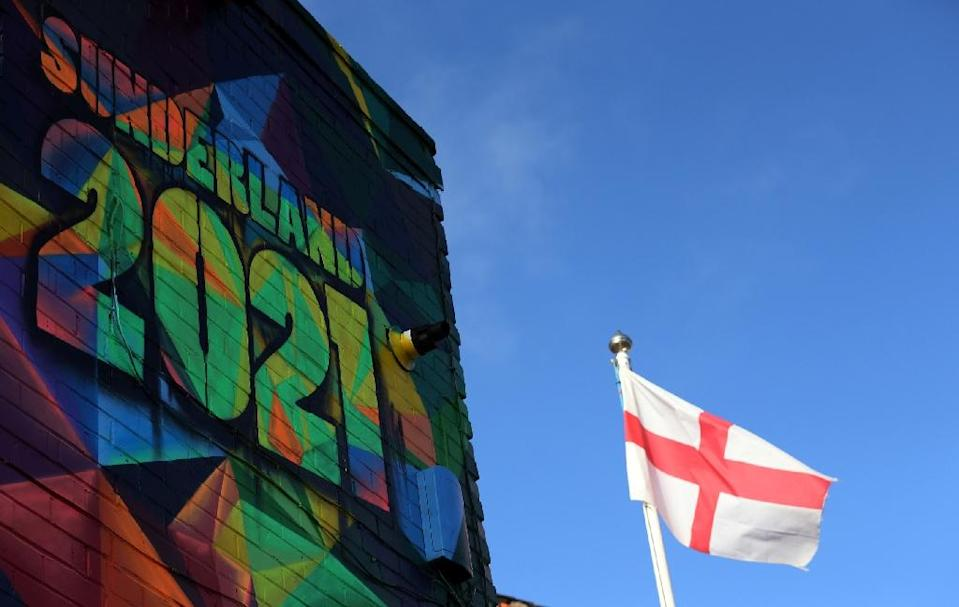A St George's cross flag flies by a mural promoting Sunderland's bid to be 2021 UK City of Culture (AFP Photo/SCOTT HEPPELL)