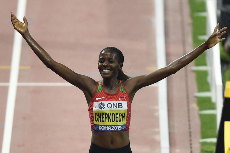 Beatrice Chepkoech, of Kenya,celebrates after crossing the finish line to win the women's 3000 meter steeplechase final during the World Athletics Championships in Doha, Qatar, Monday, Sept. 30, 2019. (AP Photo/Martin Meissner)