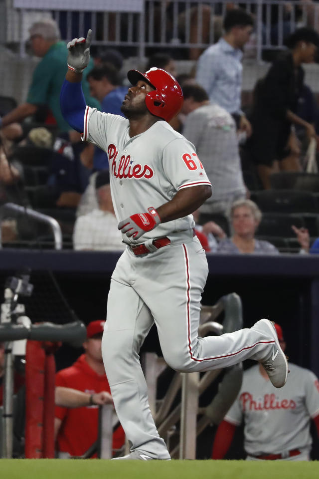 Philadelphia Phillies' Jose Pirela gestures as he runs the bases after hitting a three-run home run during the fourth inning of the team's baseball game against the Atlanta Braves on Tuesday, Sept. 17, 2019, in Atlanta. (AP Photo/John Bazemore)