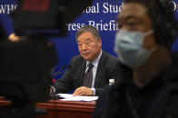Liang Wannian, the Chinese co-leader of the joint China-WHO investigation into the origins of the COVID-19 pandemic, listens to a journalist's question during a press conference in Beijing, Wednesday, March 31, 2021. Chinese health officials pushed Wednesday for expanding the search for the origins of COVID-19 beyond China, one day after the release of a World Health Organization report on the issue. (AP Photo/Mark Schiefelbein)