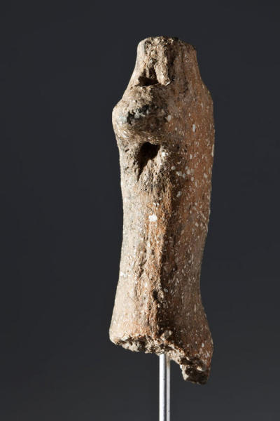 So far, only the figurine's torso, neck and right arm have been found. Archaeologists think it represents a human, probably a male.