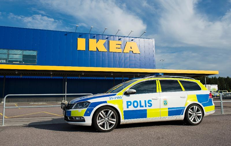 Police cars parked outside the IKEA store in the city of Vaesteraas on August 10, 2015 (AFP Photo/Jonathan Nackstrand)