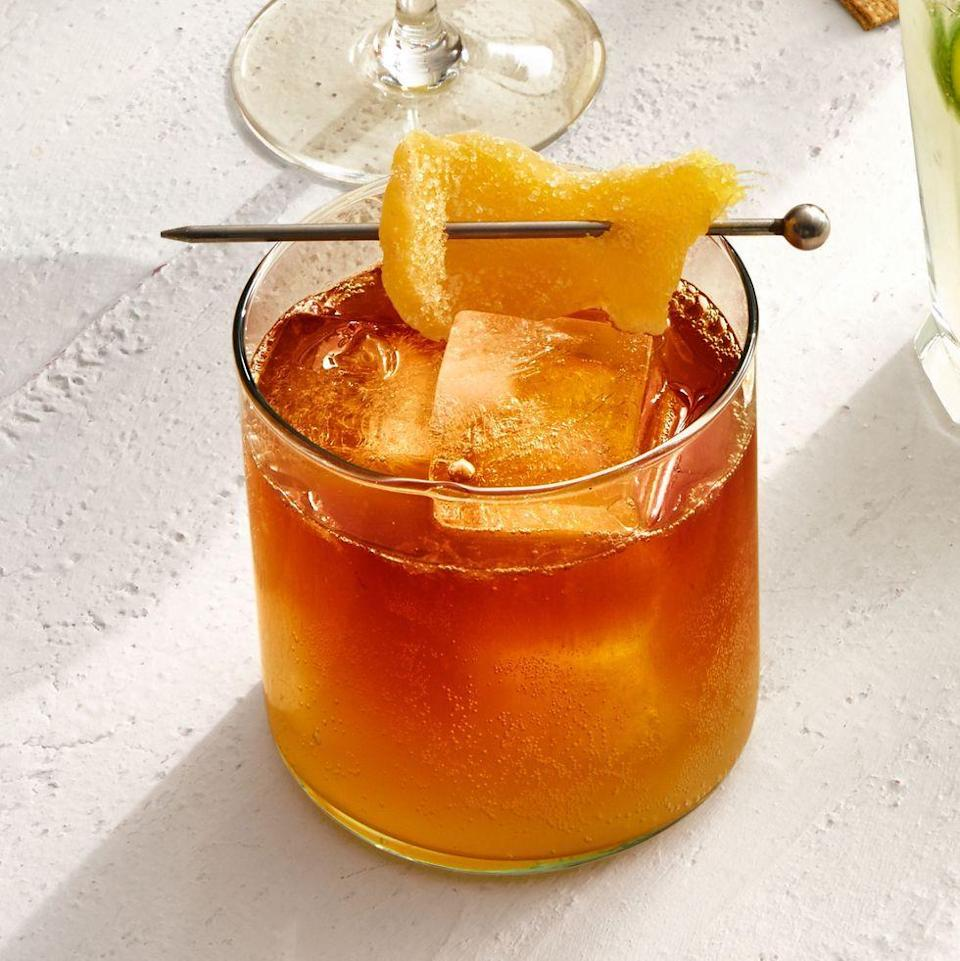 """<p>We love a classic Dark and Stormy for an autumnal evening. Stir up some fun fall color with this cocktail.<br><br><em><a href=""""https://www.goodhousekeeping.com/food-recipes/party-ideas/a28669840/dark-and-stormy-recipe/"""" rel=""""nofollow noopener"""" target=""""_blank"""" data-ylk=""""slk:Get the recipe for a Dark and Stormy »"""" class=""""link rapid-noclick-resp"""">Get the recipe for a Dark and Stormy »</a></em><br></p>"""