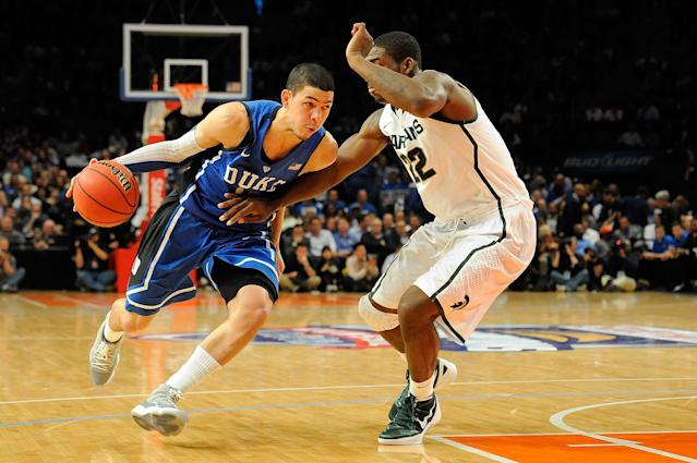 NEW YORK, NY - NOVEMBER 15: Austin Rivers #0 of the Duke Blue Devils drives the ball against Branden Dawson #22 of the Michigan State Spartans during the 2011 State Farm Champions Classic at Madison Square Garden on November 15, 2011 in New York City. (Photo by Patrick McDermott/Getty Images)