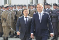 Poland's President Andrzej Duda,right, welcomes Ukraine's President Volodymyr Zelenskiy before talks on bilateral relations and Ukraine's ties with Europe under the new government, in front of the Presidential Place in Warsaw, Poland, Saturday, Aug. 31, 2019. Zelenskiy is in Warsaw with members of his new Cabinet and will attend ceremonies marking 80 years of the start of World War II on Sunday.(AP Photo/Czarek Sokolowski)
