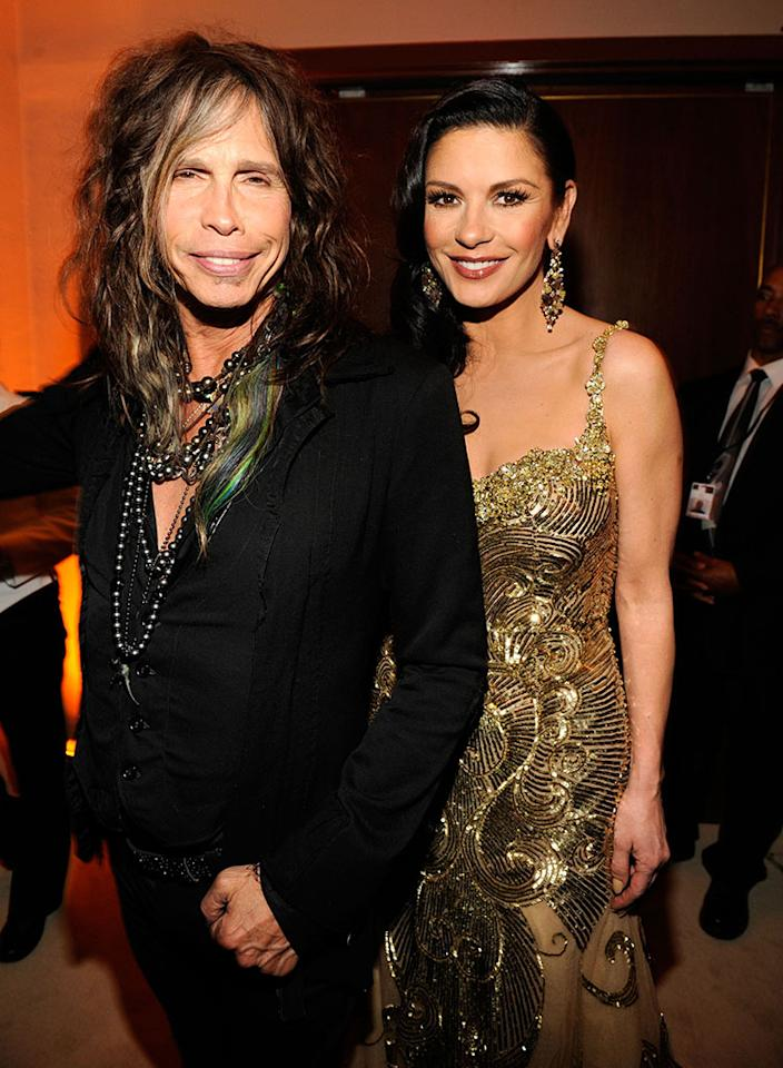 Steven Tyler and Catherine Zeta-Jones attend the 2013 Vanity Fair Oscar Party hosted by Graydon Carter at Sunset Tower on February 24, 2013 in West Hollywood, California.