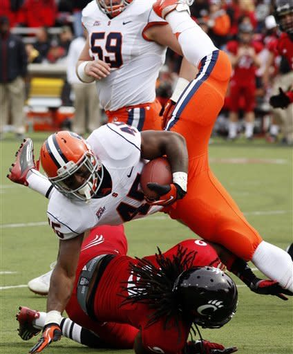 Syracuse running back Jerome Smith (45) is brought down by Cincinnati defensive back Dominique Battle (9) after a gain during the first quarter of an NCAA college football game at Nippert Stadium, Saturday Nov. 3, 2012, in Cincinnati. (AP Photo/David Kohl)