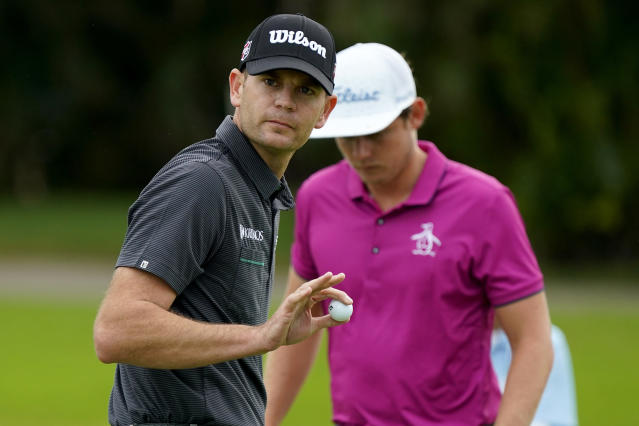 Brendan Steele waves to the gallery after saving par on the first green during the third round of the Sony Open PGA Tour golf event, Saturday, Jan. 11, 2020, at Waialae Country Club in Honolulu. (AP Photo/Matt York)