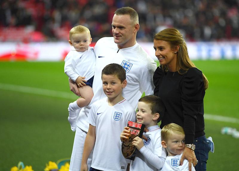 Coleen Rooney sparked criticism after allowing her children to play on iPads during a football match [Photo: Getty]