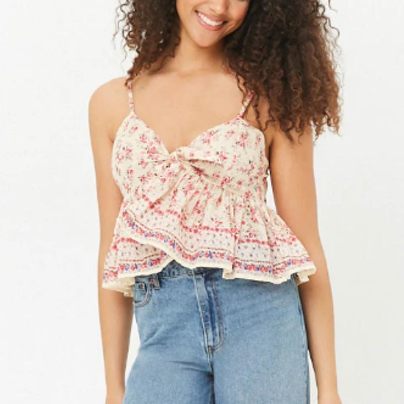 """<a rel=""""nofollow noopener"""" href=""""http://www.anrdoezrs.net/links/3550561/type/dlg/https://www.forever21.com/us/shop/catalog/product/f21/top_blouses/2000270902"""" target=""""_blank"""" data-ylk=""""slk:Floral Crop Cami, Forever 21, $18"""" class=""""link rapid-noclick-resp"""">Floral Crop Cami, Forever 21, $18</a><p> <strong>Related Articles</strong> <ul> <li><a rel=""""nofollow noopener"""" href=""""http://thezoereport.com/fashion/style-tips/box-of-style-ways-to-wear-cape-trend/?utm_source=yahoo&utm_medium=syndication"""" target=""""_blank"""" data-ylk=""""slk:The Key Styling Piece Your Wardrobe Needs"""" class=""""link rapid-noclick-resp"""">The Key Styling Piece Your Wardrobe Needs</a></li><li><a rel=""""nofollow noopener"""" href=""""http://thezoereport.com/culture/zeitgeist/best-summer-movies-watch-weekend/?utm_source=yahoo&utm_medium=syndication"""" target=""""_blank"""" data-ylk=""""slk:The Best Summer Movies To Watch This Week"""" class=""""link rapid-noclick-resp"""">The Best Summer Movies To Watch This Week</a></li><li><a rel=""""nofollow noopener"""" href=""""http://thezoereport.com/beauty/skincare/extractions-in-facial-treatments/?utm_source=yahoo&utm_medium=syndication"""" target=""""_blank"""" data-ylk=""""slk:Everything You Need To Know About Facial Extractions, Straight From The Experts"""" class=""""link rapid-noclick-resp"""">Everything You Need To Know About Facial Extractions, Straight From The Experts</a></li> </ul> </p>"""