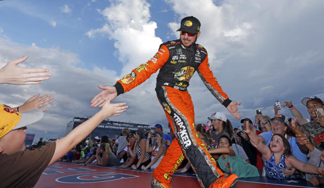 "<a class=""link rapid-noclick-resp"" href=""/nascar/sprint/drivers/380/"" data-ylk=""slk:Martin Truex Jr"">Martin Truex Jr</a>. greets fans before the NASCAR Cup Series auto race at Daytona International Speedway, Saturday, July 7, 2018, in Daytona Beach, Fla. (AP Photo/Terry Renna)"