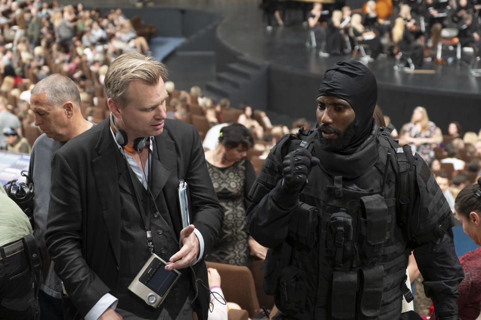 "Director/writer/producer CHRISTOPHER NOLAN and JOHN DAVID WASHINGTON on the set of Warner Bros. Pictures' action epic ""TENET,"" a Warner Bros. Pictures release. (© 2020 Warner Bros. Entertainment Inc. All Rights Reserved.)"