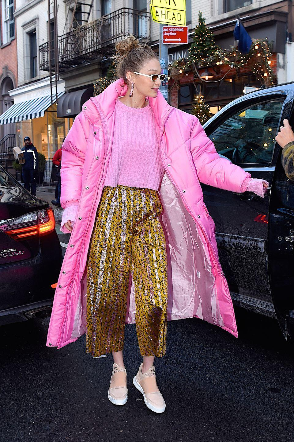 <p>In a pink Christina Ledang puffer coat and sweater, Christopher Bu pants, Filling Pieces sneakers, and Illesteva sunglasses while out in NYC.</p>