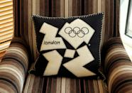 A London 2012 branded cushion is placed on an armchair at the launch of the London Olympic Games official merchandise on July 30, 2010 in London, England. (Photo by Oli Scarff/Getty Images)