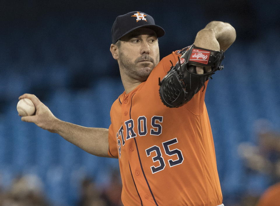 Houston Astros starting pitcher Justin Verlander throws against the Toronto Blue Jays during the first inning of a baseball game in Toronto, Sunday, Sept. 1, 2019. (Fred Thornhill/The Canadian Press via AP)