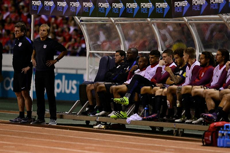 United States' players on the bench react during their 2018 FIFA World Cup qualifier football match against Costa Rica on November 15, 2016