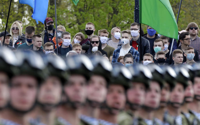 People attend the Victory Day military parade that marked the 75th anniversary of the allied victory over Nazi Germany, in Minsk, Belarus, Saturday, May 9, 2020. Belarus remains one of the few countries that hadn't imposed a lockdown or restricted public events despite recommendations of the World Health Organization. (AP Photo/Sergei Grits)