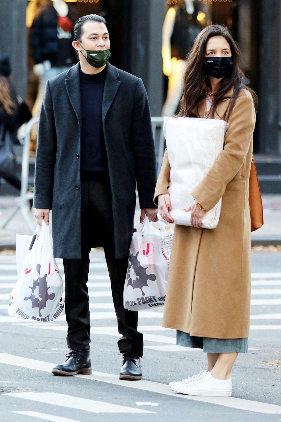 <p>Katie Holmes and her boyfriend Emilio Vitolo Jr. have their hands full after shopping in N.Y.C. on Monday. </p>