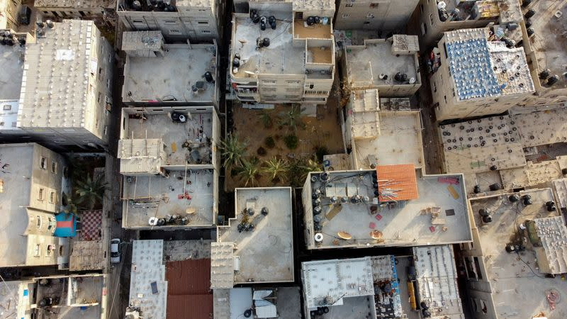 A picture taken with a drone shows Palestinian houses and buildings at Beach refugee camp in Gaza City