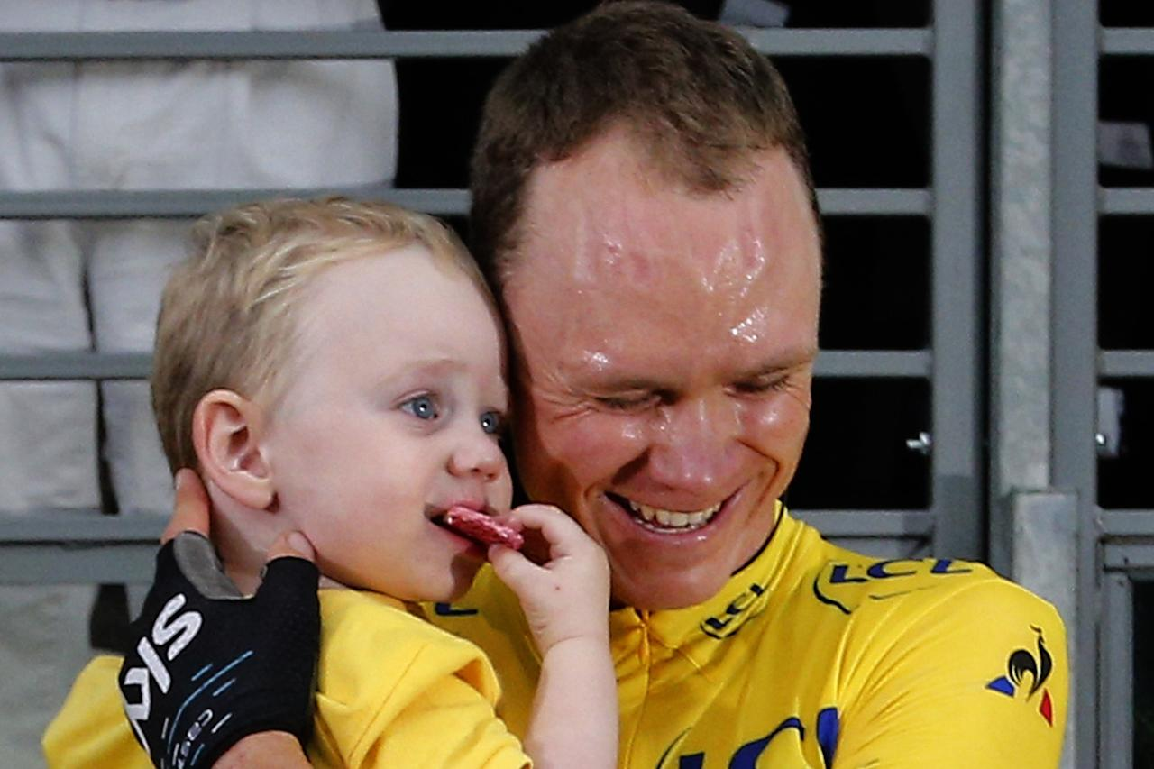 <p>Tour de France winner Chris Froome celebrates his fourth yellow jersey victory with a hug from his son Kellan after three weeks of racing. (AP Photo) </p>