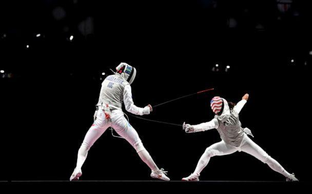 PHOTO: Inna Deriglazova of Team ROC, left, competes against Lee Kiefer of Team United States in the Women's Foil Individual Fencing Gold Medal Bout on day two of the Tokyo 2020 Olympic Games on July 25, 2021 in Chiba, Japan.  (Matthias Hangst/Getty Images)